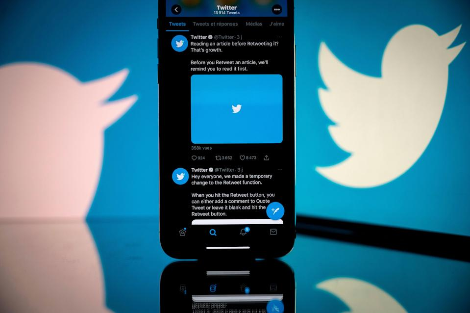 Twitter logo displayed on the screen of a smartphone and a tablet in Toulouse (AFP via Getty Images)