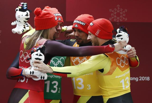Luge - Pyeongchang 2018 Winter Olympic Games - Team Relay - Pyeongchang, South Korea - February 15, 2018 - Gold medalists Natalie Geisenberger, Johannes Ludwig, Tobias Wendl and Tobias Arlt of Germany celebrate during the victory ceremony. REUTERS/Edgar Su