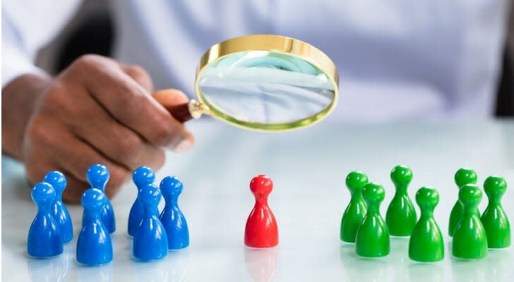 Looking through a magnifying glass at a chess piece