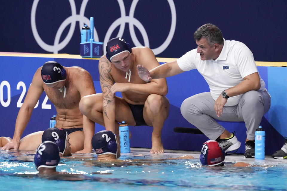 United States' head coach Dejan Udovicic talks to players during a preliminary round men's water polo match against Greece at the 2020 Summer Olympics, Monday, Aug. 2, 2021, in Tokyo, Japan. (AP Photo/Mark Humphrey)