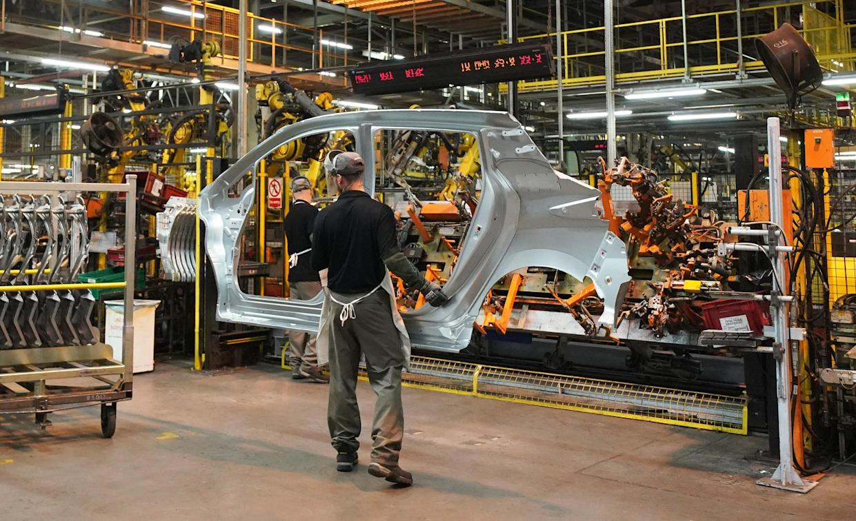 File photo dated 10/10/19 of workers on the production line at Nissan's factory in Sunderland. The number of cars built in the UK has fallen for the 18th month in a row, showing the ongoing impact of the coronavirus crisis on the industry, figures show. Issue date: Friday March 26, 2021.