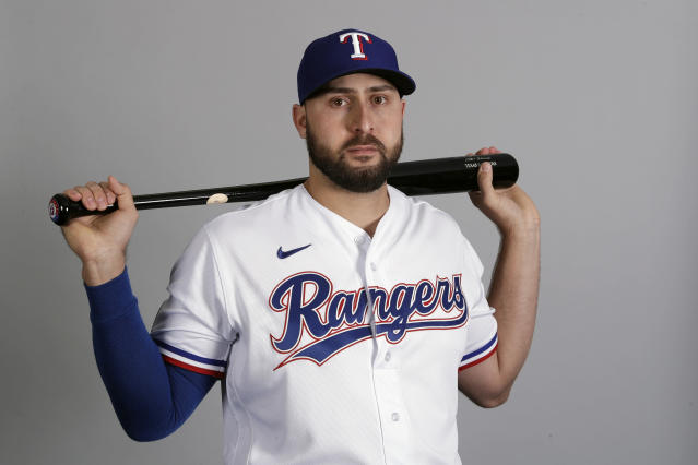 FILE - This is a 2020 file photo showing Joey Gallo of the Texas Rangers baseball team. Rangers slugger Joey Gallo has tested positive for COVID-19, though the team says the All-Star right fielder is asymptomatic. General manager Jon Daniels said Monday, July 6, 2020, that Gallo is isolated at his apartment in Dallas and not around teammates. (AP Photo/Charlie Riedel, File)