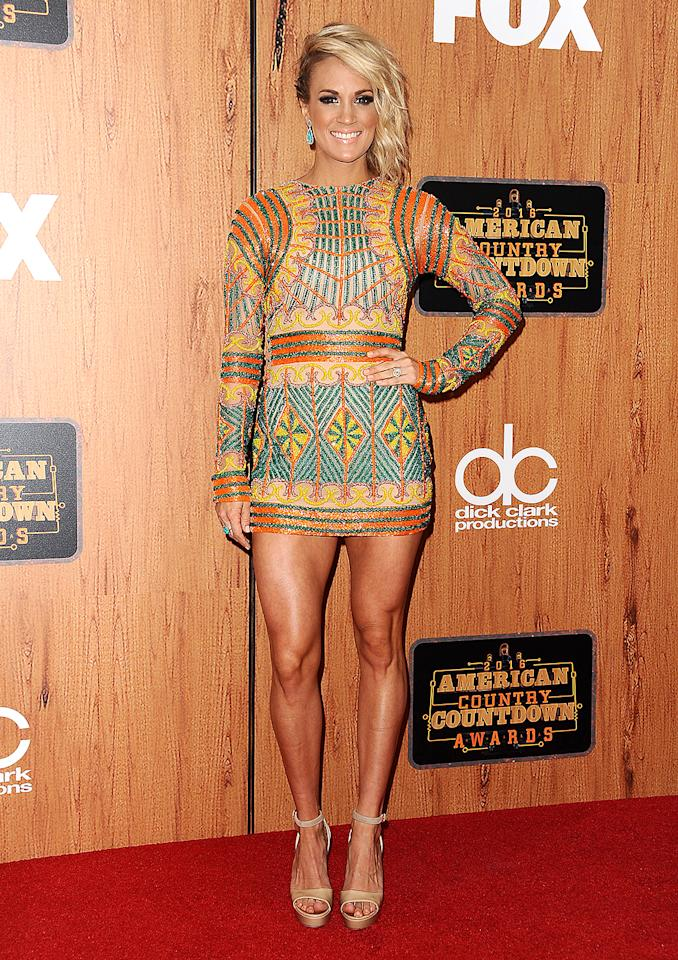 <p>If we had gams like Carrie Underwood, we'd <em>always</em> wear dresses as short as the one she donned for the 2016 American Country Countdown Awards. (Photo: Jason LaVeris/FilmMagic) </p>
