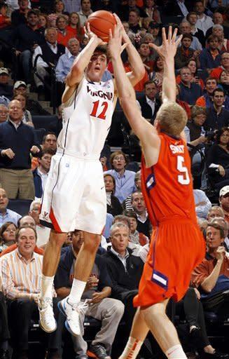 Virginia guard Joe Harris (12) shoots a 3-pointer over Clemson guard Tanner Smith (5) during the second half of an NCAA college basketball game, Tuesday, Jan. 31, 2012, in Charlottesville, Va. Virginia won 65-61. (AP Photo/Andrew Shurtleff)