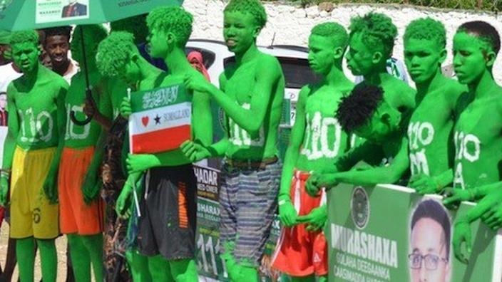 People painted in colours Justice and Development party