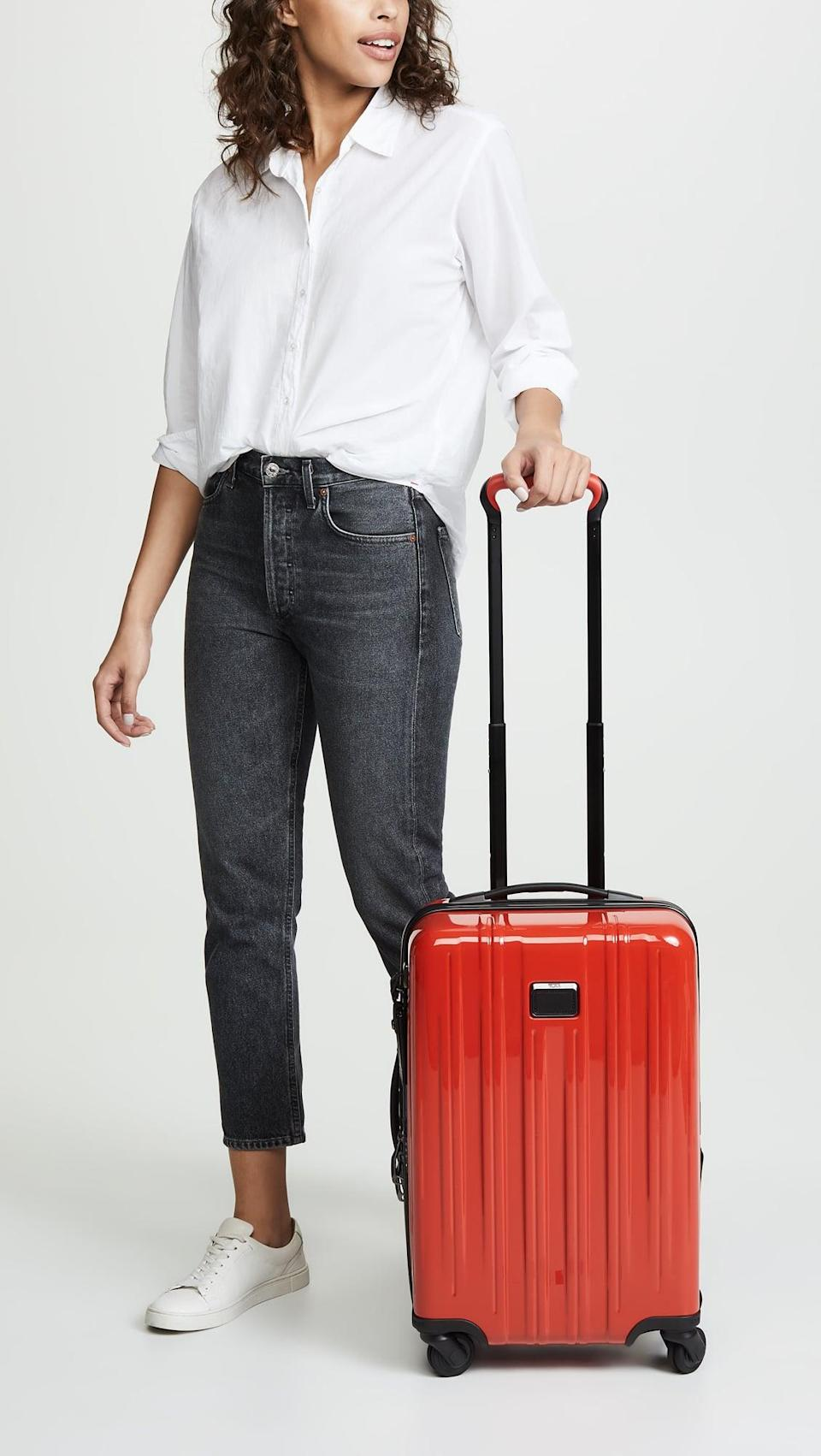 <p>Nobody will mistake their suitcase with your <span>Tumi Short Trip Expandable Packing Case</span> ($415, originally $595). It's compact and great for quick trips.</p>