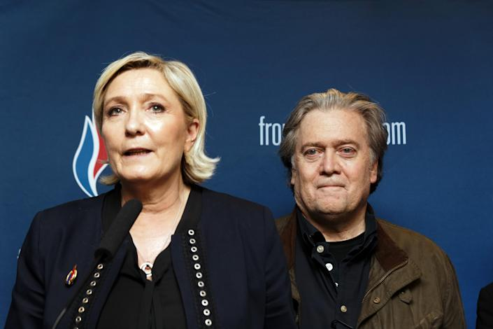 Steve Bannon with France's Marine Le Pen at a press conference last March. (Photo: Sylvain Lefevre/Getty Images)