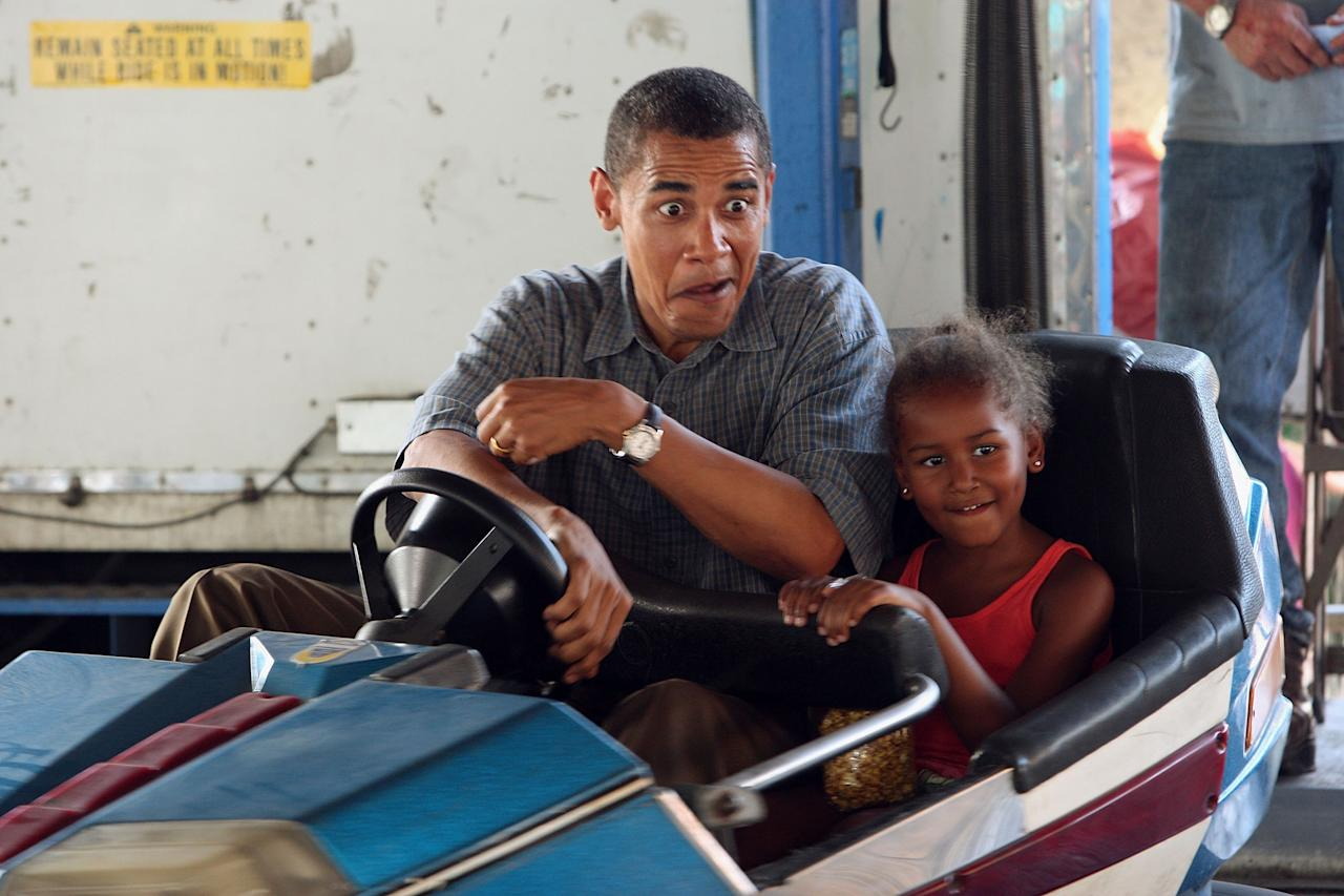 Democratic Presidential Candidate Senator Barack Obama (D-IL) drives a bumper car with his daughter Sasha at the Iowa State Fair August 16, 2007 in Des Moines, Iowa. (Photo by Scott Olson/Getty Images)