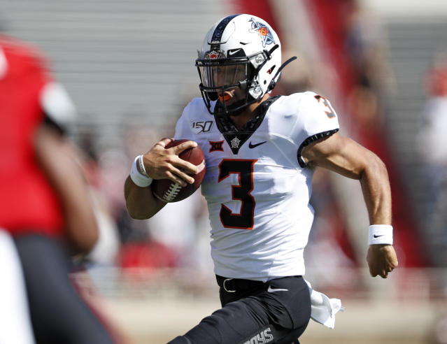 Oklahoma State's Spencer Sanders (3) runs with the ball during the first half of an NCAA college football game against Texas Tech, Saturday, Oct. 5, 2019, in Lubbock, Texas. (AP Photo/Brad Tollefson)