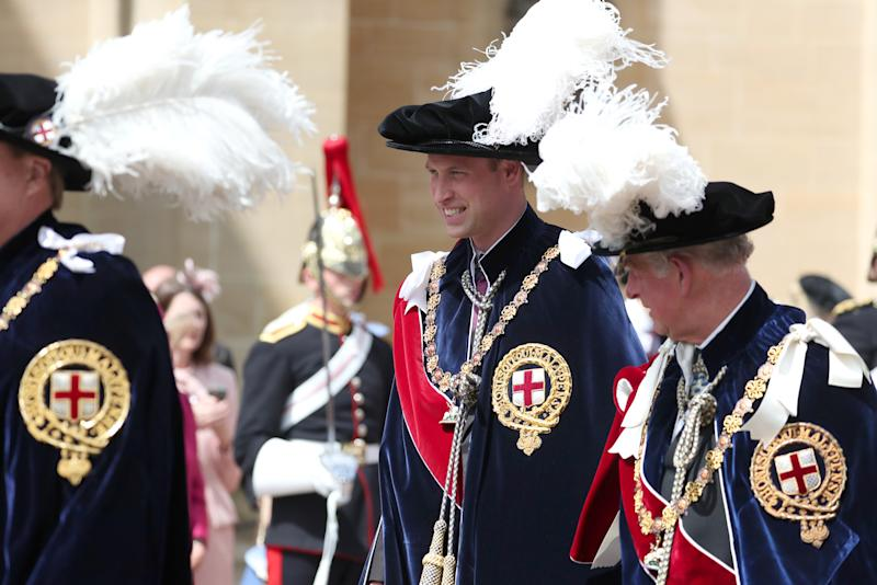 The Duke of Cambridge (centre) walks with his father the Prince of Wales (right) during the annual Order of the Garter Service at St George's Chapel, Windsor Castle.