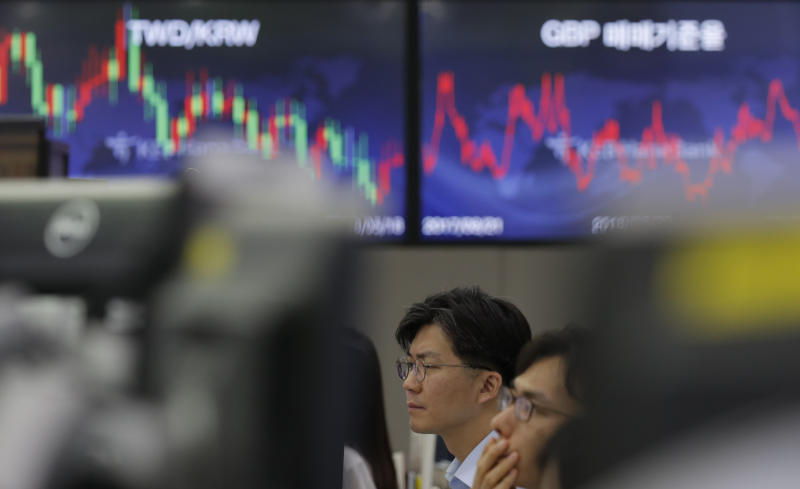 Currency traders watch their computer monitors at the foreign exchange dealing room in Seoul, South Korea, Tuesday, Sept. 3, 2019. Asian stock markets were mostly lower Tuesday after investor jitters over U.S.-Chinese trade tension were revived by a report negotiators cannot agree on a schedule for talks this month. (AP Photo/Lee Jin-man)
