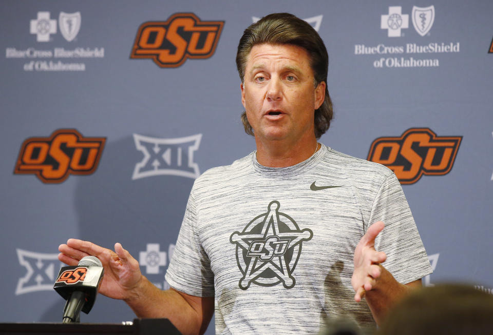Oklahoma State head coach Mike Gundy gestures as he answers a question during an NCAA college football media day in Stillwater, Okla., Saturday, Aug. 4, 2018. (AP Photo/Sue Ogrocki)