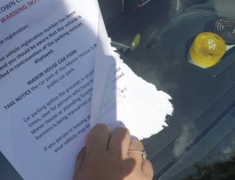 Workers from Dawlish Town Council reportedly glued the notice onto the windscreen. (SWNS)