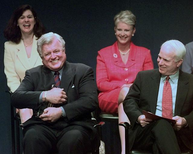<p>Sen. Edward Kennedy jokingly holds the Profile in Courage award lantern as if he intends to keep it, as co-winner, Senator John McCain looks on during ceremonies at the John F. Kennedy Library in Boston, Mass., on May 24, 1999. In back row are their spouses, Victoria Kennedy, left, and Cindy McCain. (Photo: Elise Amendola/AP) </p>