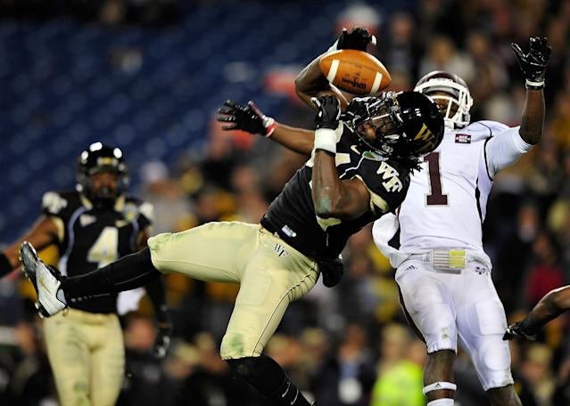 NASHVILLE, TN - DECEMBER 30: Duran Lowe #34 of the Wake Forest Demon Deacons intercepts a pass in the end zone intended for Chad Bumphis #1 of the Mississippi State Bulldogs during play at the Franklin American Mortgage Music City Bowl at LP Field on December 30, 2011 in Nashville, Tennessee. (Photo by Grant Halverson/Getty Images)