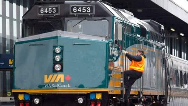 VIA Rail says that running passenger trains on dedicated lines, rather than on shared tracks with freight trains, would reduce travel times and make the service more reliable. (Adrian Wyld/The Canadian Press - image credit)