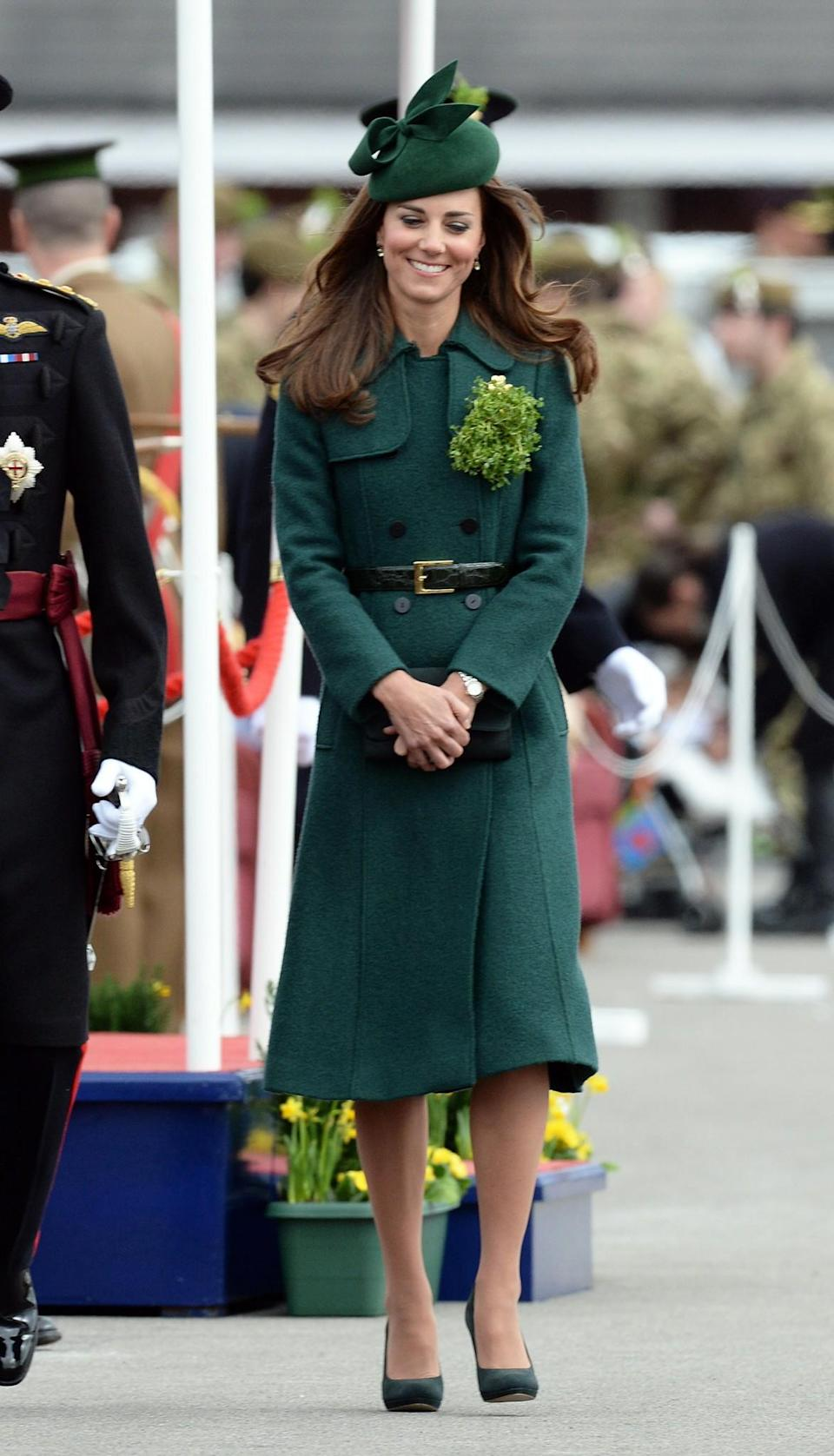 <p>In 2014, the Duchess looked bronzed from her recent holiday with the Duke of Cambridge in the Maldives. She covered up in a Hobbs coat, and wore her sun-kissed locks loose in soft waves. Again, Kate pinned on the Queen Mothers brooch for the occasion. <em>[Photo: PA]</em> </p>
