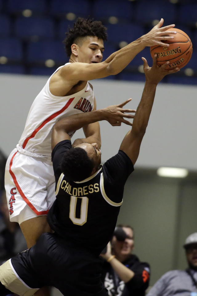Arizona guard Josh Green, top, blocks a shot by Wake Forest guard Brandon Childress during the first half of an NCAA college basketball game at the Wooden Legacy tournament in Anaheim, Calif., Sunday, Dec. 1, 2019. (AP Photo/Alex Gallardo)