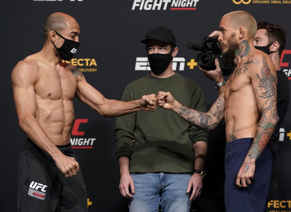 LAS VEGAS, NEVADA - DECEMBER 18: (L-R) Opponents Jose Aldo of Brazil and Marlon Vera of Ecuador face off during the UFC Fight Night weigh-in at UFC APEX on December 18, 2020 in Las Vegas, Nevada. (Photo by Cooper Neill/Zuffa LLC via Getty Images)