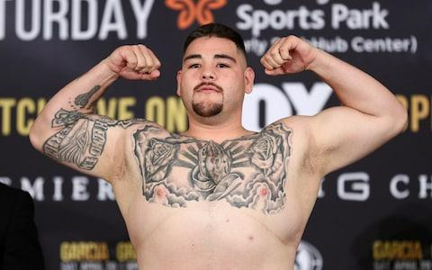 Andy Ruiz Jr. poses on the scale during his official weigh-in ahead of his heavyweight bout against Alexander Dimitrenko at Sheraton Gateway Hotel on April 19, 2019 in Los Angeles, California - Credit: Getty Images
