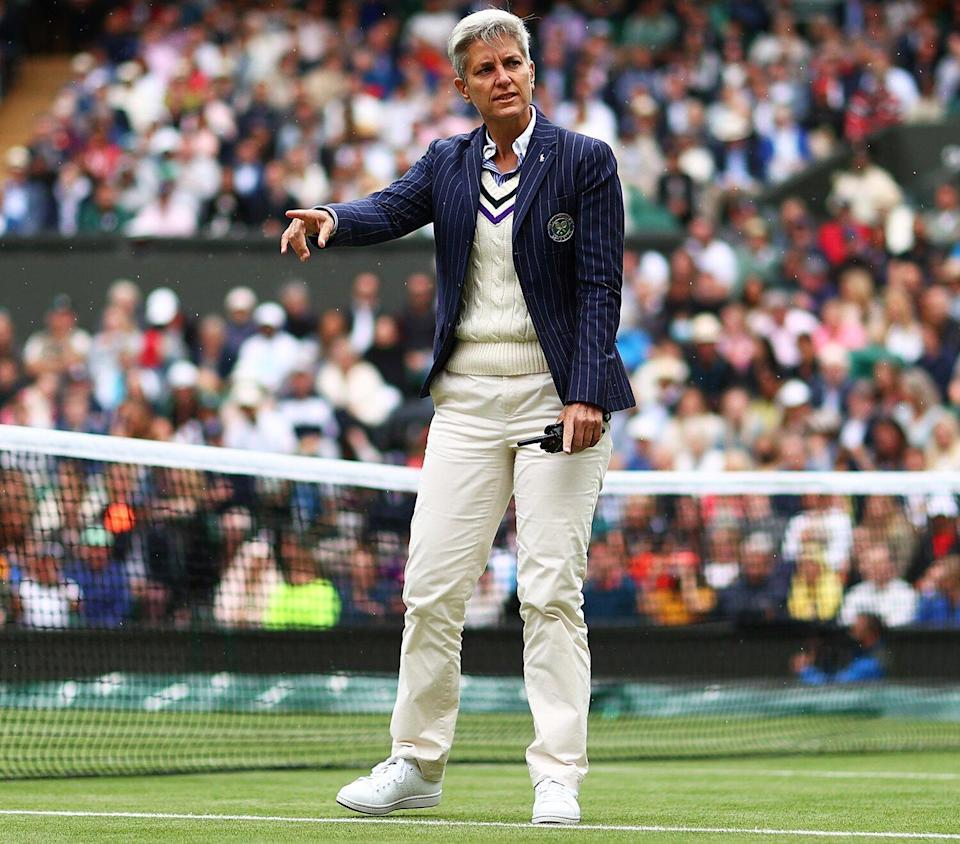 Umpire Marija Cicak of Croatia as the players go off for a rain delay in his Men's Singles Fourth Round match against Lorenzo Sonego of Italy during Day Seven of The Championships - Wimbledon 2021 at All England Lawn Tennis and Croquet Club on July 05, 2021 in London, England.