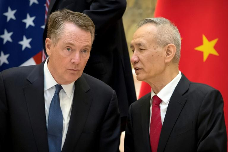 US Trade Representative Robert Lighthizer (L) and Chinese Vice Premier Liu He line up for a group photo at the Diaoyutai State Guesthouse in Beijing in February 2019