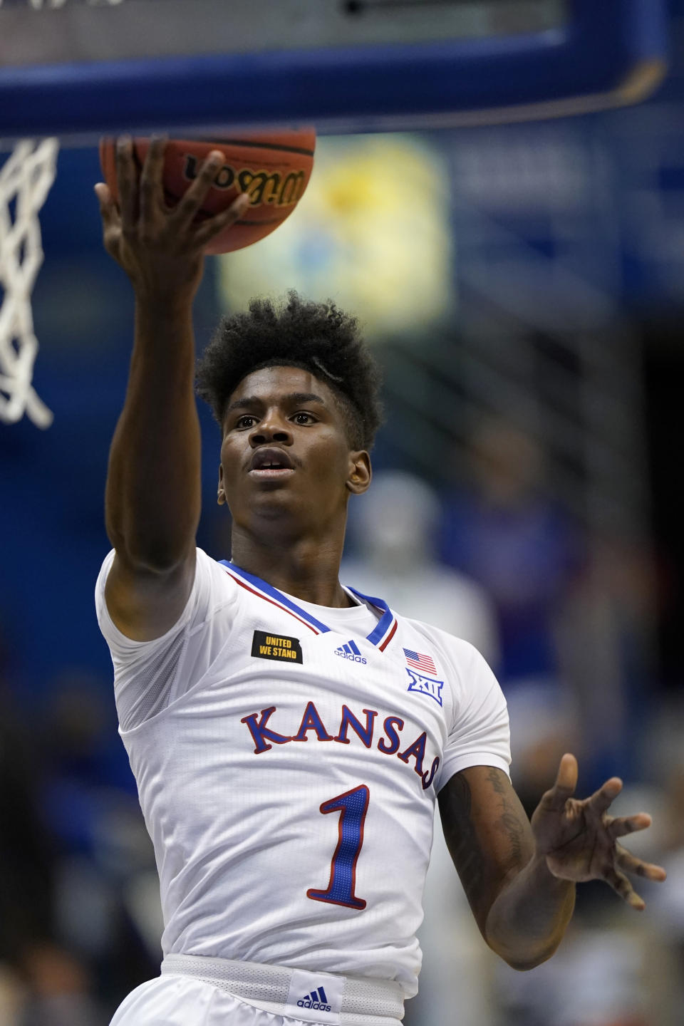 Kansas guard Tyon Grant-Foster drives for a basket during the first half of the team's NCAA college basketball game against Washburn in Lawrence, Kan., Thursday, Dec. 3, 2020. (AP Photo/Orlin Wagner)