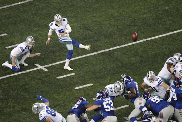 Dallas Cowboys punter Chris Jones (6) holds as kicker Dan Bailey makes a 30-yard field goal against the New York Giants during the first half of an NFL football game, Sunday, Sept. 8, 2013, in Arlington, Texas. (AP Photo/Tony Gutierrez)
