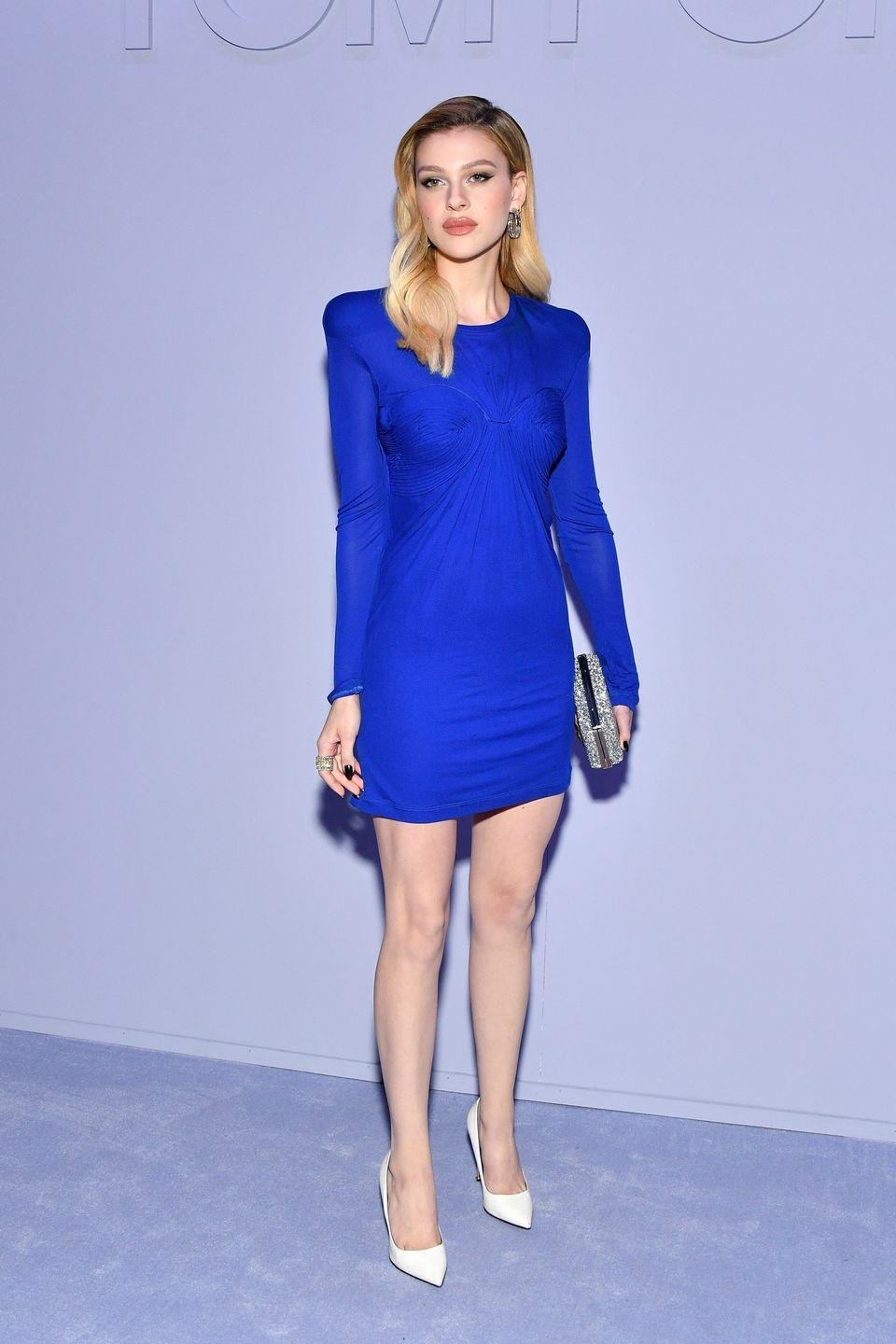 <p>The star dazzled in an electric blue peacock blue Tom Ford mini dress with shoulder pad detailing, styled with a pair of white stilettos. <br></p>