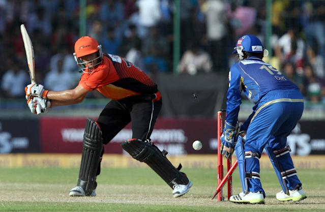 Ashton Agar of Perth Scorchers bowled out by Pragyan Ojha during the CLT20 match between Perth Scorchers and Mumbai Indians at Feroz Shah Kotla, Delhi on Oct. 2, 2013. (Photo: IANS)
