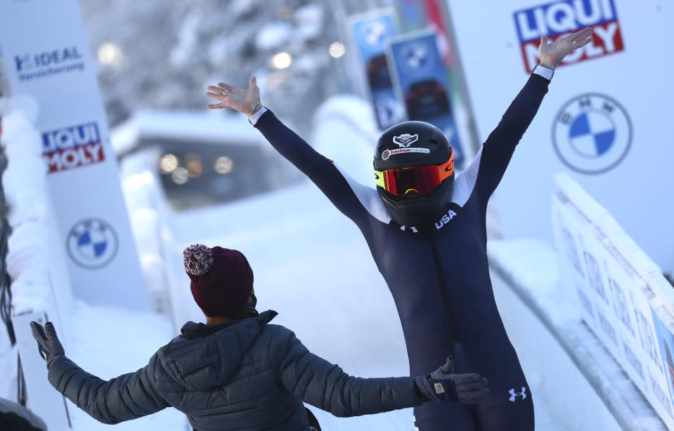 Bobsleigh pilot Kaillie Humphries of the United States reacts at the finish line after taking first place during the women's monobob race at the Bobsleigh and Skeleton World Championships in Altenberg, Germany, Sunday, Feb.14, 2021. (AP Photo/Matthias Schrader)
