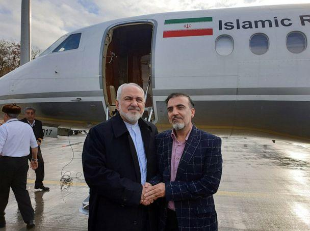 PHOTO: A handout photo made available by Iranian Foreign Affairs Minister Mohammad Javad Zarif's twitter account on December 7, 2019 shows Zarif (L) greeting Iranian researcher Masoud Soleimani at an undisclosed airport in Switzerland. (IRANIAN FOREGIN MINISTRY HANDOUT/EPA-EFE/REX)