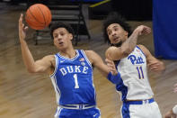 FILE - In this Jan. 19, 2021, file photo, Duke's Jalen Johnson (1) gets a rebound next to Pittsburgh's Justin Champagnie during the first half of an NCAA college basketball game in Pittsburgh. Johnson left Duke in February to prepare for the draft with about a month left in his freshman season. (AP Photo/Keith Srakocic, File)