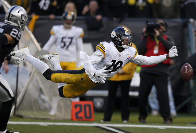 <p>Pittsburgh Steelers wide receiver JuJu Smith-Schuster (19) cannot catch a pass against the Oakland Raiders during the second half of an NFL football game in Oakland, Calif., Sunday, Dec. 9, 2018. (AP Photo/D. Ross Cameron) </p>