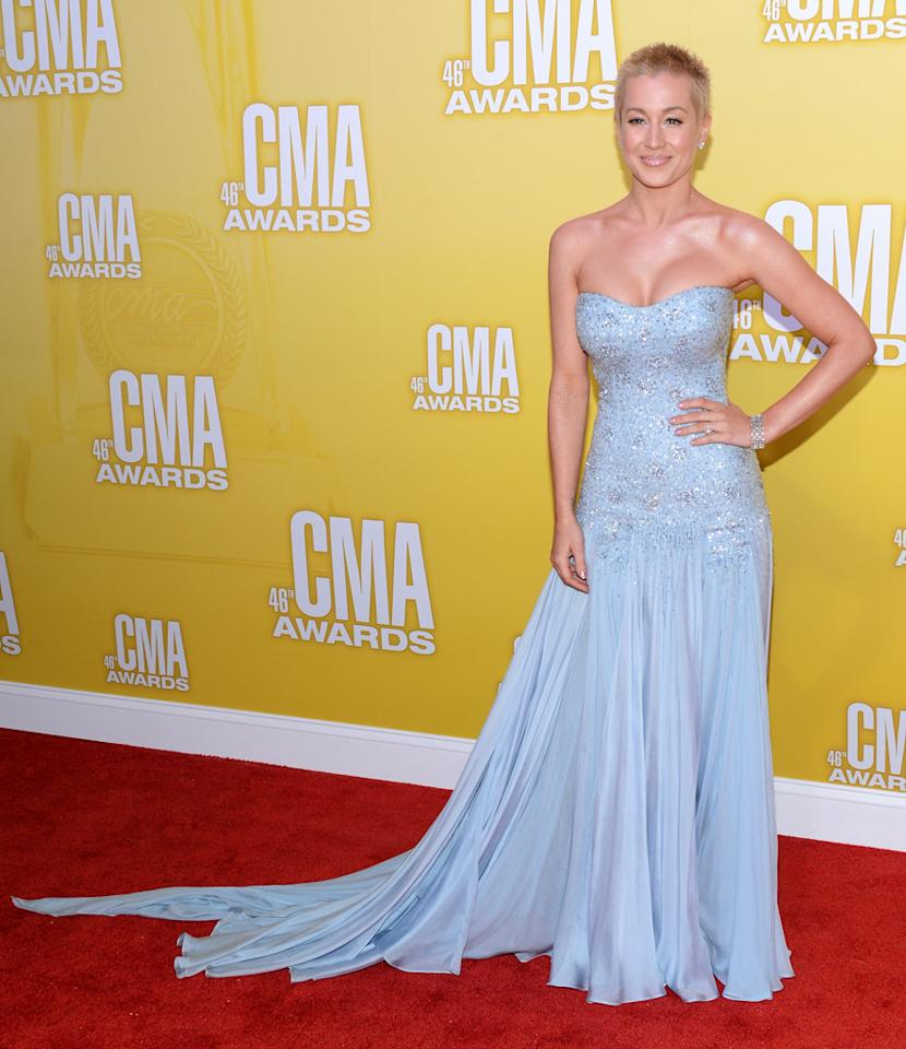 "<p class=""MsoNormal""><span style=""color:black;"">Kellie Pickler – who recently shaved her head in support of a friend </span>being treated for cancer –<span style=""color:black;""> stunned on the red carpet at the 46<sup>th</sup> Annual CMA Awards held at the Bridgestone Arena in Nashville. The singer flaunted her fab physique in a flowing ice blue gown featuring a sparkling bodice. A pair of diamond stud earrings and her sassy short 'do were all she needed to complete this fabulous look! (11/1/2012)<br></span></p>"
