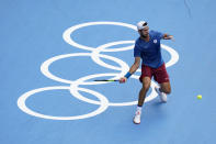 Karen Khachanov, of the Russian Olympic Committee, returns to Pablo Carreno Busta, of Spain, during the semifinal round of the men's tennis competition at the 2020 Summer Olympics, Friday, July 30, 2021, in Tokyo, Japan. (AP Photo/Patrick Semansky)