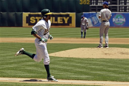 Oakland Athletics' Coco Crisp heads toward home plate after his solo home run off Texas Rangers starting pitcher Yu Darvish, right, during the third inning of a baseball game, Thursday, June 7, 2012, in Oakland, Calif. (AP Photo/Marcio Jose Sanchez)