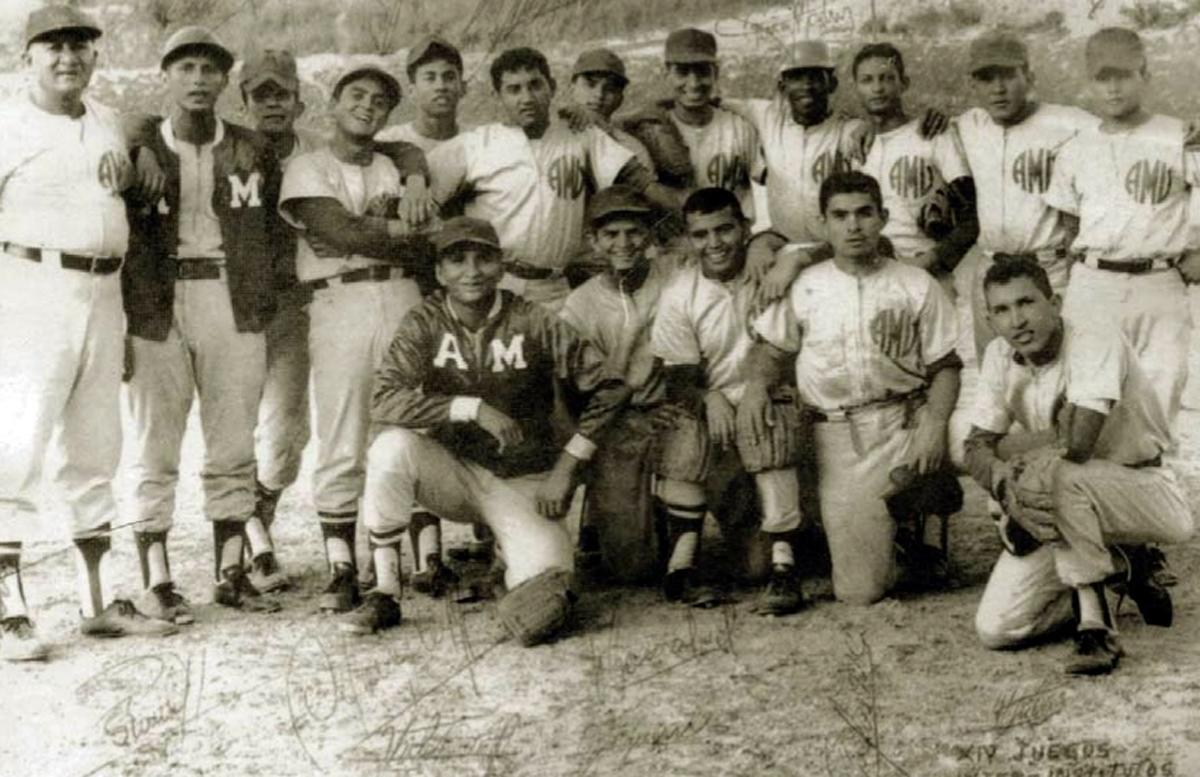In this March 1972 photo released by Miraflores Press Office, Hugo Chavez, bottom row, right, poses with his baseball teammates during the internal games at the Military Academy in Caracas, Venezuela. Venezuela's Vice President Nicolas Maduro announced on Tuesday, March 5, 2013 that Chavez has died. Chavez, 58, was first diagnosed with cancer in June 2011. (AP Photo/Miraflores Press Office)