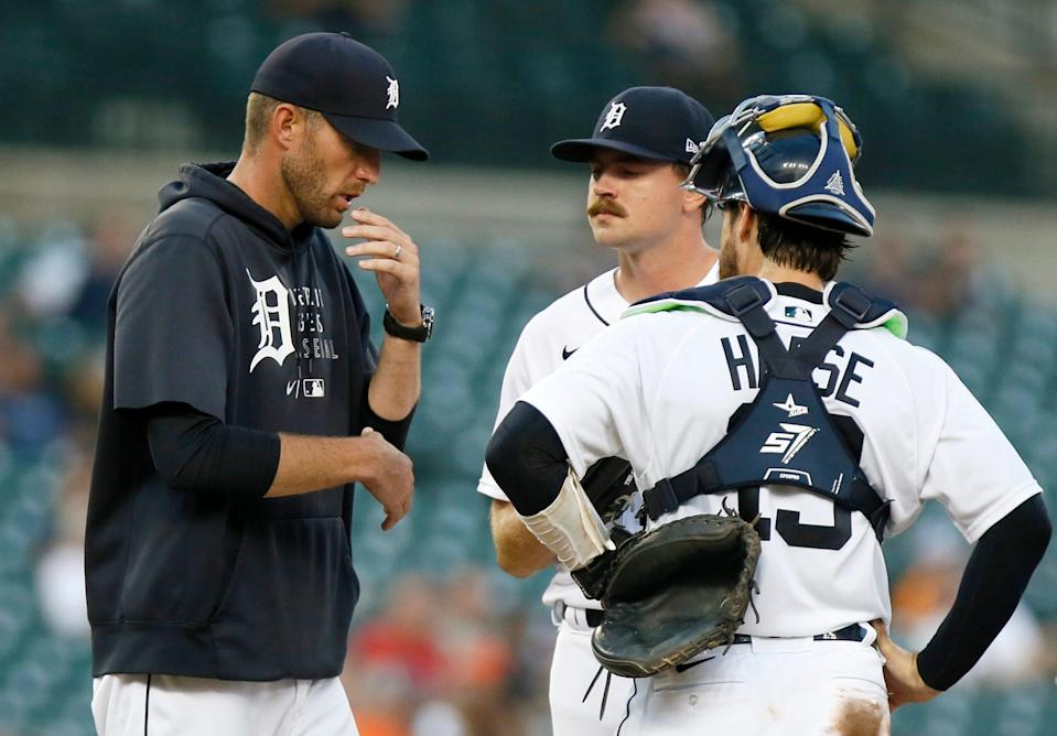 Pitching coach Chris Fetter (left) of the Detroit Tigers visits pitcher Tyler Alexander and catcher Eric Haase (right) during the sixth inning at Comerica Park on Aug. 28, 2021 in Detroit.
