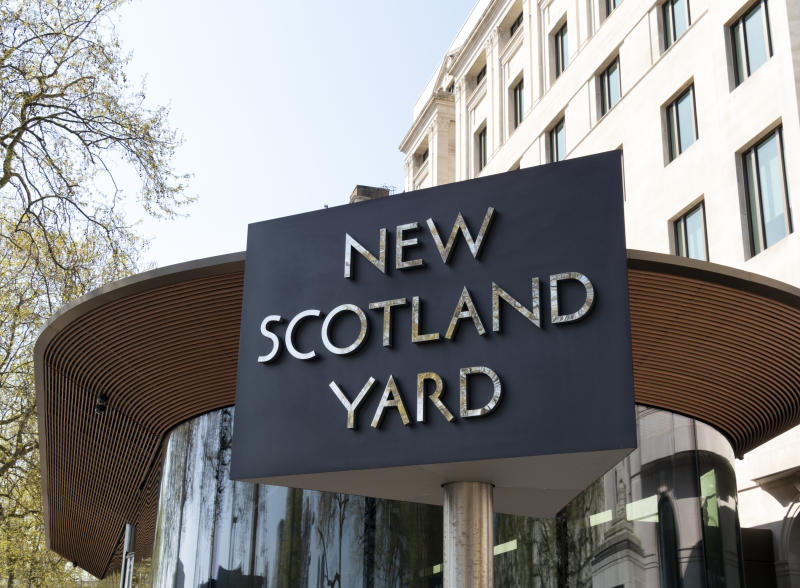 A revolving sign outside New Scotland Yard on the Victoria Embankment in London. New Scotland Yard is the headquarters of the Metropolitan Police Service (MPS). The headquarters has moved several times since the inception of 'the Met' in 1829 and was originally in Whitehall Place and backing on to Great Scotland Yard, from whence derived the name 'Scotland Yard'