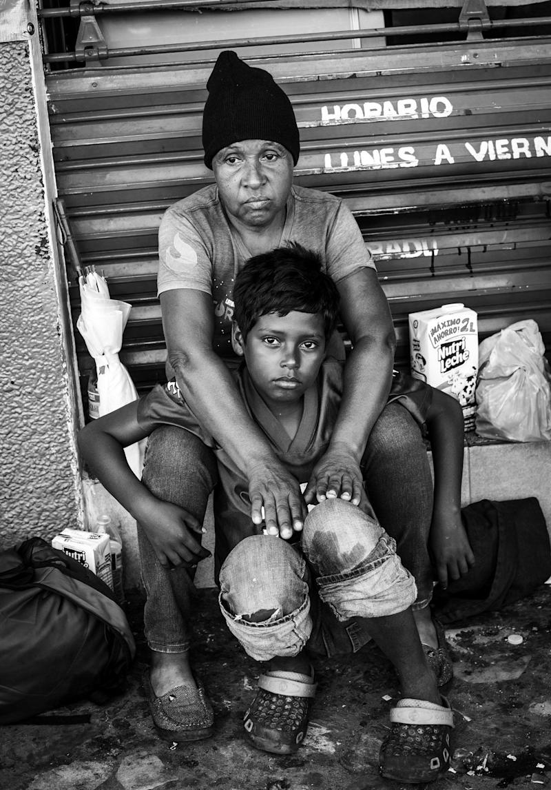 Maria and her son fled Honduras to escape the M13 gang when she was unable to pay her monthly extortion fees. As a result, gang members robbed her house and attempted to recruit her son.