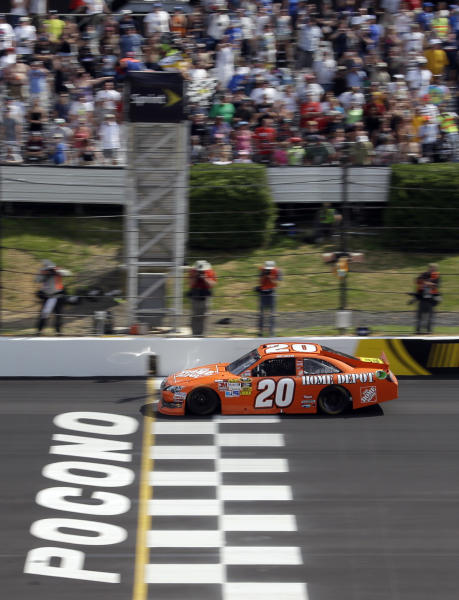 Joey Logano crosses the finish line to win the NASCAR Sprint Cup Series Pocono 400 auto race on Sunday, June 10, 2012, in Long Pond, Pa. (AP Photo/Matt Slocum)