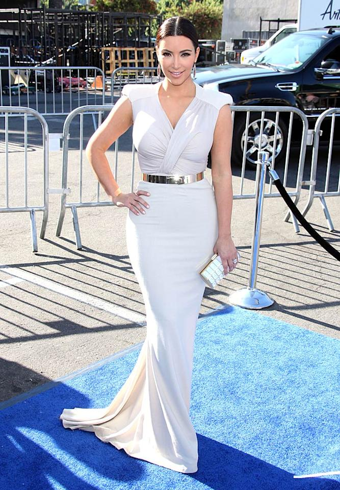 """Kim Kardashian -- who is set to wed this coming weekend -- rocked the blue carpet at this year's Do Something Awards in a ruched Antonio Berardi showstopper. The ivory frock -- which retails for a whopping $2,600 -- hugged the curvaceous reality star in all the right places. Jen Lowery/<a href=""""http://www.splashnewsonline.com"""" target=""""new"""">Splash News</a> - August 14, 2011"""