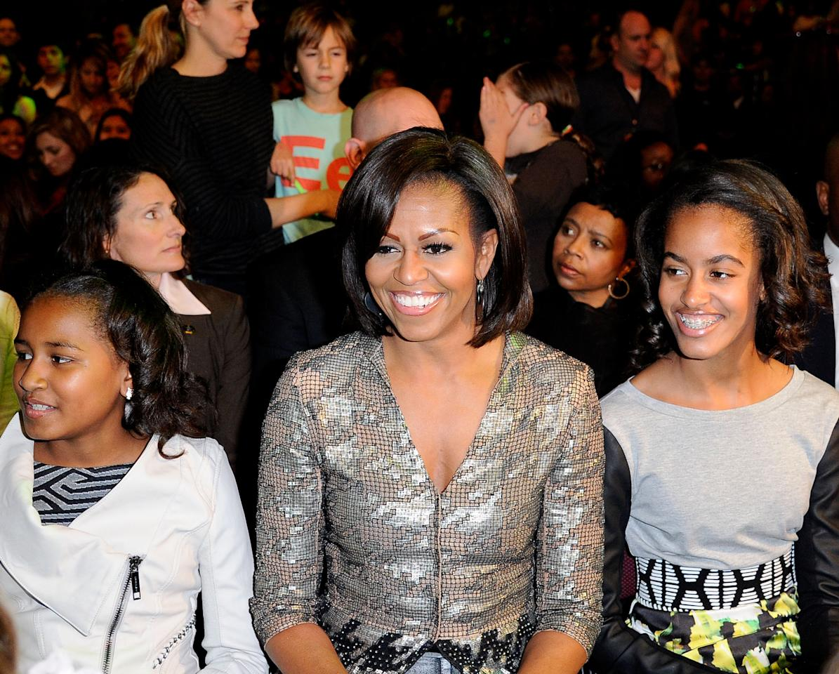 (L-R) Sasha Obama, First Lady Michelle Obama and Malia Obama at Nickelodeon's 25th Annual Kids' Choice Awards held at Galen Center on March 31, 2012 in Los Angeles, California.  (Photo by Kevork Djansezian/Getty Images)