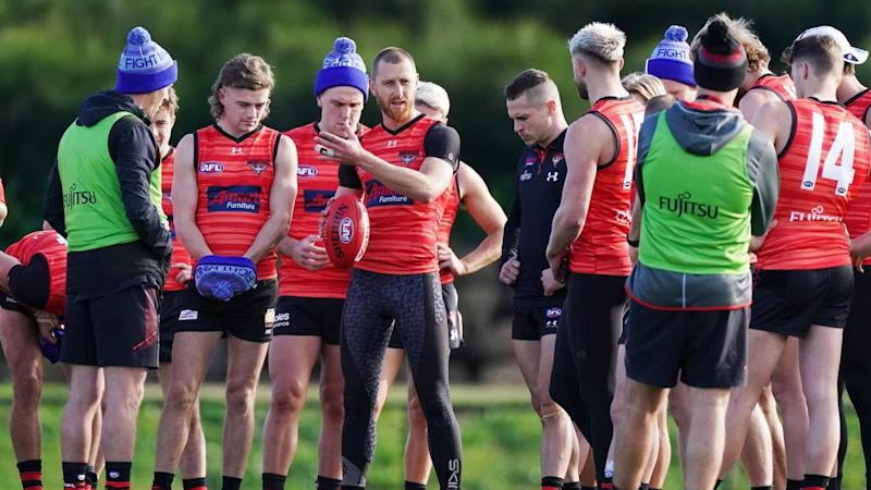 Essendon captain Dyson Heppell (centre) has shrugged of fitness concerns to play the Swans