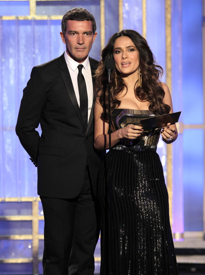 BEVERLY HILLS, CA - JANUARY 15: In this handout photo provided by NBC, actor Antonio Banderas and actress Salma Hayek present an award onstage during the 69th Annual Golden Globe Awards at the Beverly Hilton International Ballroom on January 15, 2012 in Beverly Hills, California. (Photo by Paul Drinkwater/NBC via Getty Images)