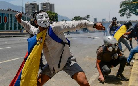 <span>National Guards fired tear gas at a hardcore of demonstrators after the majority of protesters went home</span> <span>Credit: MATIAS DELACROIX/AFP </span>