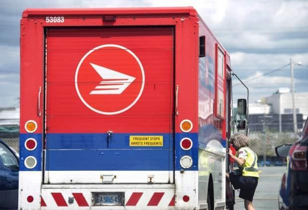 Nearly one million Canadians may have had their names and addresses exposed in a cyberattack on one of Canada Post's partners. (Darren Calabrese/The Canadian Press - image credit)