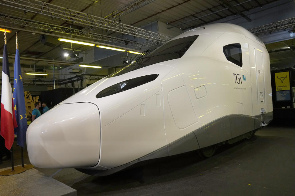 """A life-size replica of the next high-speed train TGV is pictured at the Gare de Lyon station Friday, Sept. 17, 2021 in Paris. France unveils a super-fast, climate-friendly train of the future, the next generation of its high-speed TGV trains that have been emulated around the world. French President Emmanuel Macron and other government officials are holding a ceremony at the historic Gare de Lyon train station in Paris to mark 40 years since the unveiling of the first TGV, or """"train a grand vitesse."""" (AP Photo/Michel Euler, Pool)"""