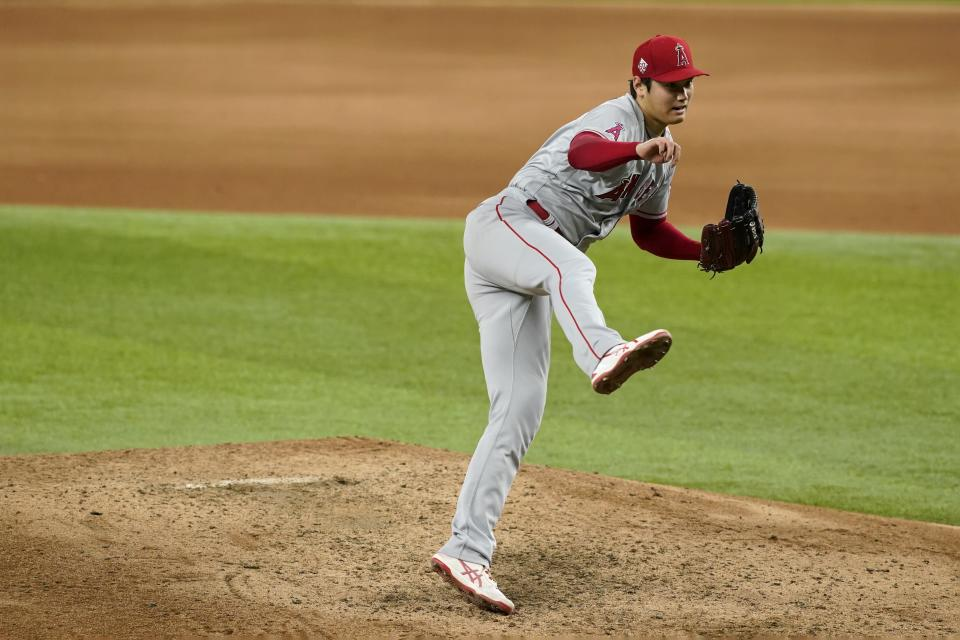 Los Angeles Angels starting pitcher Shohei Ohtani follows through on his delivery to the Texas Rangers in the sixth inning of a baseball game in Arlington, Texas, Wednesday, Aug. 4, 2021. (AP Photo/Tony Gutierrez)